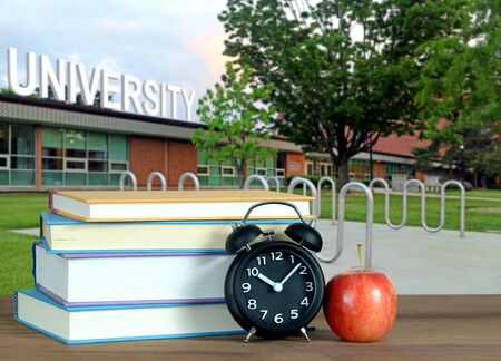 An Education Concept with books and Campus of University Banque d'images - 137146474