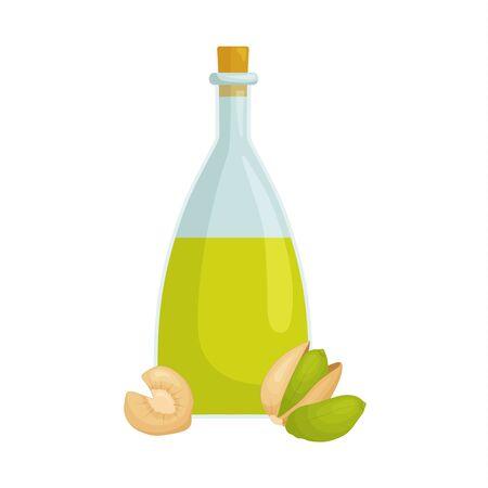 Bottle with liquid pistachio oil. Composition with pistachios and a bottle.