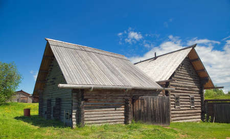 The russian house 'izba', permo-koryak style under the blue sky with cloud Stock Photo - 7272939