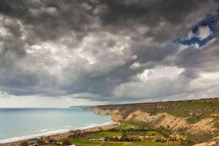 Dark sky over coastline at Cyprus photo