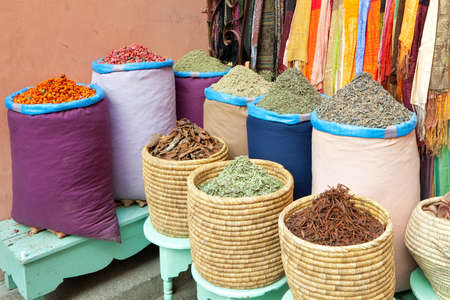 Colorful spices in bags selling at Marrakesh, Morocco market photo