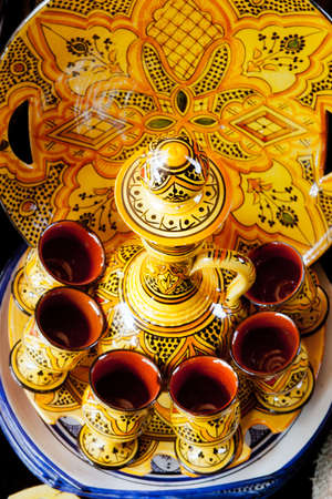Traditional moroccan pot and cups photo