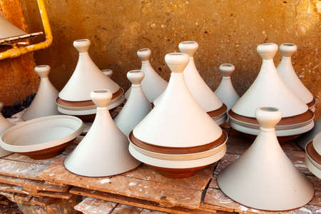 Moroccan dishware drying before roasting photo