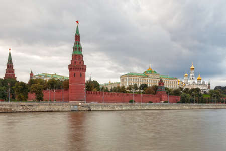 russian federation: View to Moscow Kremlin from Sofiyskaya embankment over river under dark heavy clouds, Russian Federation