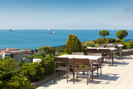 Empty cafe tables high over city and Marmara sea, Istanbul, Turkey photo