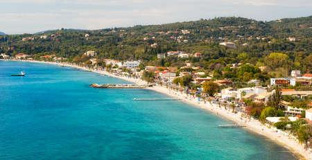 Aerial view to beach under sunlight at Pirgi villadge, Ipsos, Corfu, Greece photo