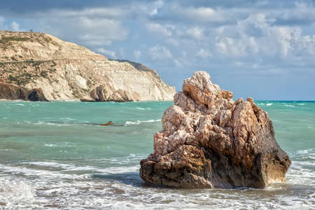 Rock at empty pebble beach Petra tou Romiou at early spring, Cyprus