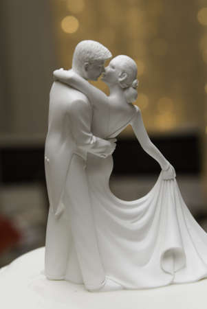 Figures on a wedding cake dancing photo