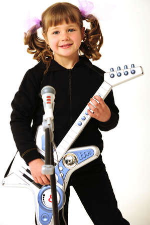 young girl play guitar and singing photo