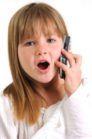 little girl surprised: beautifull brunette girl surprised and talking on a mobile phone