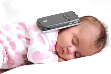 sms text: infant baby sleeping with a mobile phone