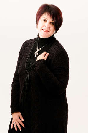 fuller figure: Beautiful attractive fuller figure mature short haired woman with hand on shoulder dressed in black knitted jacket