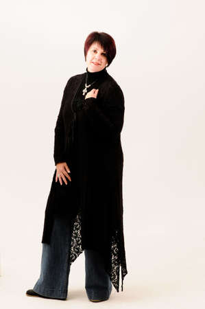 fuller figure: Beautiful attractive fuller figure mature short haired woman dressed in jeans and black knitted jacket