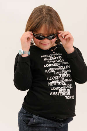 chubby girl: young beautiful  teenager touching her sun glasses smiling with dimple in cheek Stock Photo