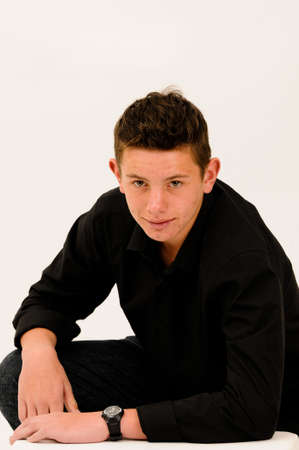young short haired teenager sitting and smiling photo