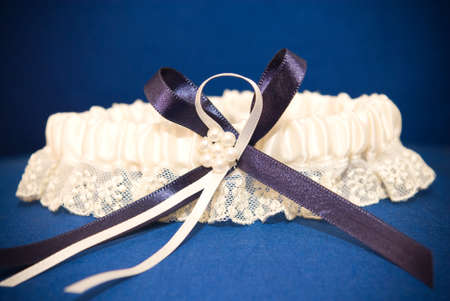 Wedding decor of a blue garter with robbon of lint and lace