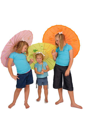 three young pretty girls playing with colorful umbrellas in studio photo