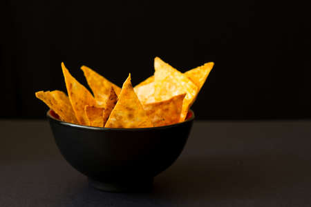 tureen: Fried spicy lavash chips in black tureen