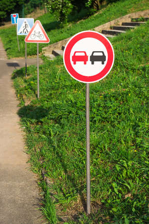 warning signs: no overtaking, no passing sign on the training kids track in the park