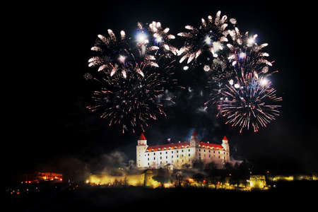 New Year and Independence day celebration in Bratislava, Slovakia. Fireworks above the Bratislava Castle