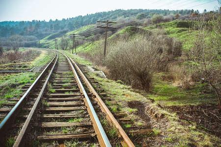 turns: The train railway turns upleft in summer landscape