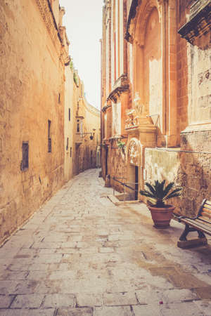 warm color: Ancient narrow street in Mdina, Malta. Warm color filter used Stock Photo