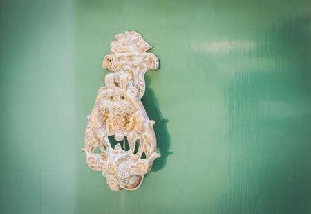 green door: Old Metal Knocker on Green Door in Mdina, Malta. Space for your text Stock Photo