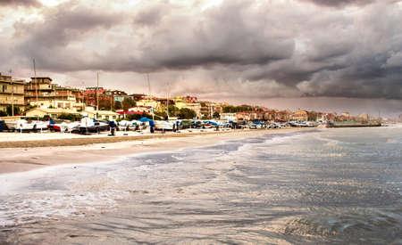 Beautiful landscape of the coast with dramatic sky and choppy sea. Falconara, Italy. Stock Photo