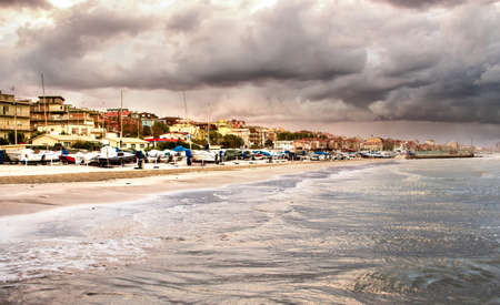choppy: Beautiful landscape of the coast with dramatic sky and choppy sea. Falconara, Italy. Stock Photo