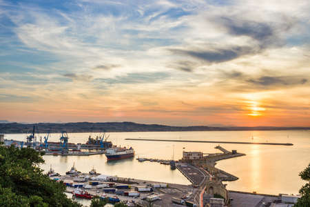 Industrial commercial port at sunset, Ancona, Italy. View from the hill Stock Photo