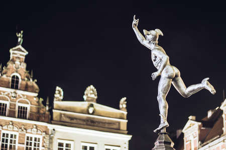 messengers of god: GDANSK, POLAND - JANUARY 1, 2015: Statue of Hermes in Old Town of Gdansk by night, Poland