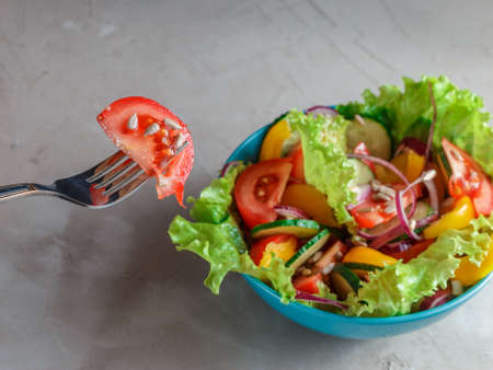 sunflower seeds: Fresh Summer Vegetable Salad in blue bowl