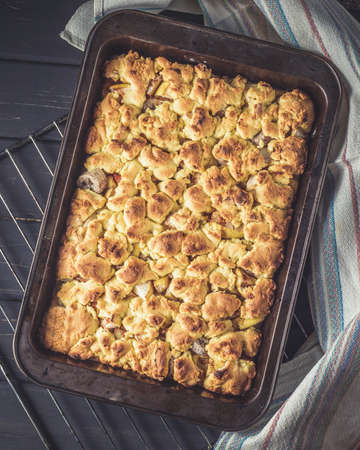 food stuff: Baking pan with fresh pie just baked and taken out from oven and ready to eat. Baking concept, making pie process