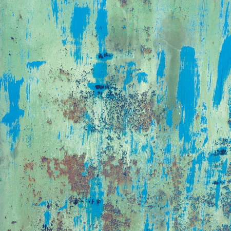 scratched: Old blue painted wall with rust texture. Grunge rusted metal background. Rust stains.