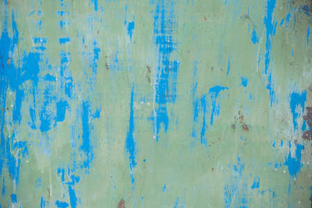 Old blue painted wall with rust texture. Grunge rusted metal background. Rust stains.