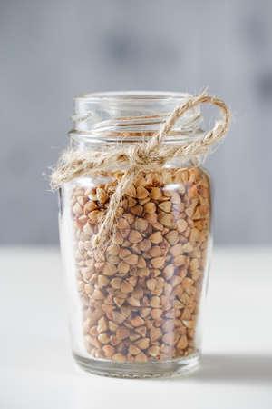 selenium: Uncooked buckwheat in glass jar. Close up Stock Photo