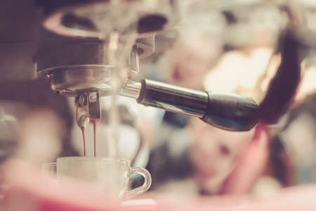 Coffee Preparation using professional coffee machine in the cafe, Shallow depth of field, pastel color soft toning