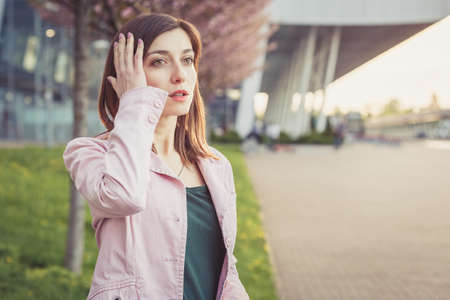 Forgetful woman touching her head having just realized she made a mistake or forgot something