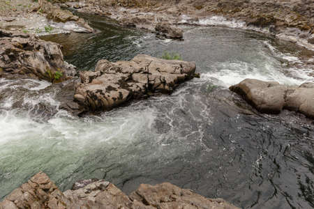 Fast mountain river with rocks, scenic landscape, usa