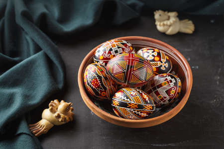 Pysanky in a bowl, Ukrainian Easter eggs decorated with wax-resist dyeing technique, traditional for Eastern European countries