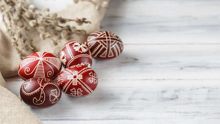 Pysanky, Ukrainian Easter eggs decorated with wax-resist dyeing technique, willow tree brunches and linen cloth