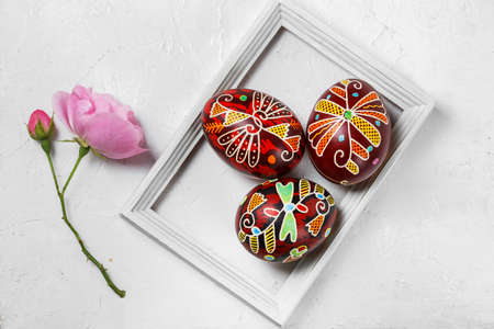 Pysanky, Ukrainian Easter eggs decorated with wax-resist dyeing technique on white wooden background Stock fotó