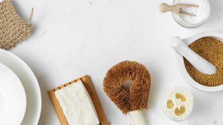 Set of Zero Waste products for Sustainable Dish Washing, Luffa Sponge, Vegan Dishwashing Solid Soap, Coconut Bristle Brush, Biodegradable Scrubber, Soda and Mustard, copy space, frame