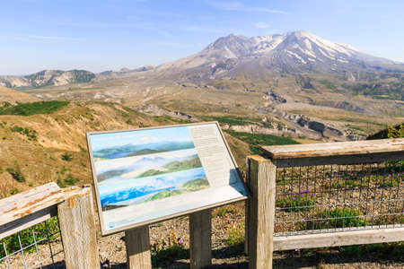 Washington state, USA - June 24, 2018: View on Mount St. Helens and the valley at the foot with an information sign in the foreground