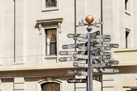 Street sign pointing in various directions with mileage. Famous Portland OR Downtown Singnpost Landmark Imagens