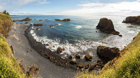 High angle panoramic view on Cobble Beach below Yaquina Head lighthouse in Newport, Oregon