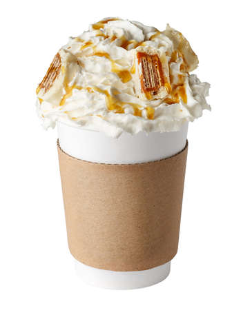 Coffee drink covered with whipped cream, chocolate syrup and candies in paper cup to go isolated on white background