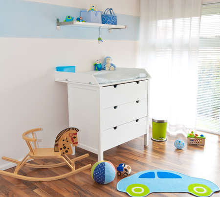 Modern childrens playroom with changing table
