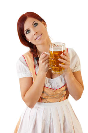 Redheaded bavarian female holding a Glass of Beer wearing a Dirndl Stock Photo - 10615491