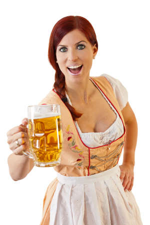 Redheaded bavarian female holding a Glass of Beer wearing a Dirndl